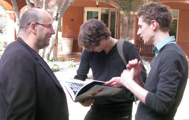 Raul, Javier and Nicky check out the gifts they received from DreamWorks.