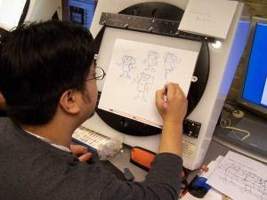 grad Frances Acupan demos his drawing prowess