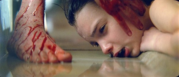 CG fire, an acid eroded face and digital vampire makeup grace this horror remake. Courtesy of Overture Films.