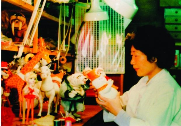 [Figure 1.11] Kyoko Kita works on Animagic puppets for Rudolph and Frosty's Christmas in July. (© 1979 Rankin/Bass Productions/Rick Goldschmidt Archives.)