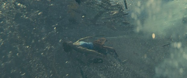 Scanline created a CG double of the water to match the live-action water, and used tennis balls to locate the exact motion pattern of the actress underwater.