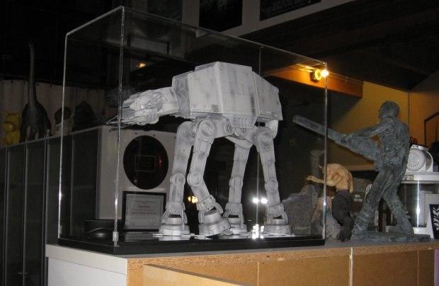 A Star Wars Imperial Walker model kept within a case in the foyer.