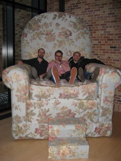 Sashka, Jakob and Max share a seat in the lobby lounge.