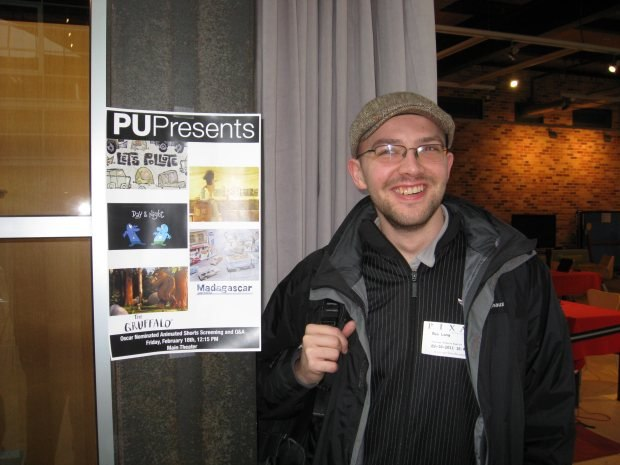 Max stands beside a Pixar University poster for the Oscar Tour screening.