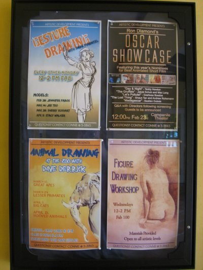 One of the Showcase Tour posters visible around the campus.
