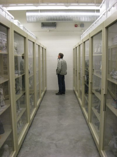 Geefwee Boedoe examines various maquettes housed in long rows of cabinets within one of the climate controlled vaults.