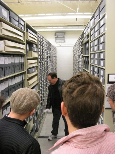 As the picture shows, the vaults contain row after row of storage boxes, all categorized and labeled for easy physical retrieval. I found listening to head researcher Fox Carney just as interesting as looking at the artwork.