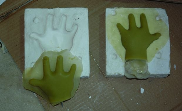 [Figure 3.66] Silicone cast hands sitting in their molds.