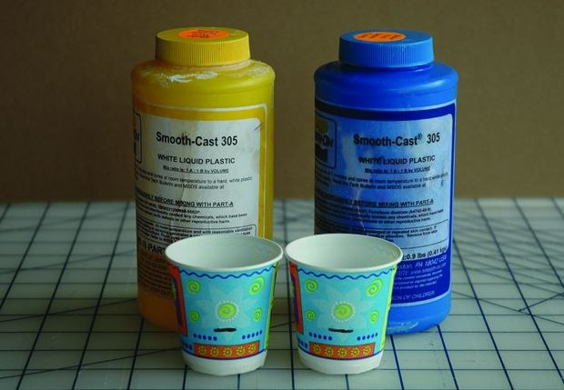 [Figure 3.76] Bottles of two-part plastic, with cups marked for the amounts to mix together.