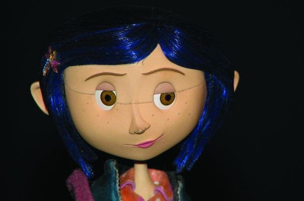 [Figure 3.110] Photo of the Coraline puppet, showing the face divided into halves. ([c] Focus Features.)