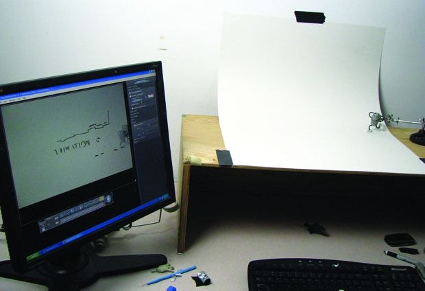 [Figure 3.122] The Thunderbean animation in progress, with reference markers on the monitor and onion skin for positioning.