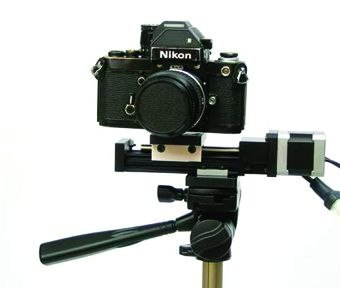 [Figure 4.29] Camera-sliding tripod attachment for