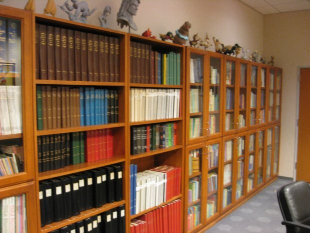 Scripts, books and memorabilia adorn a long wall within the archive.