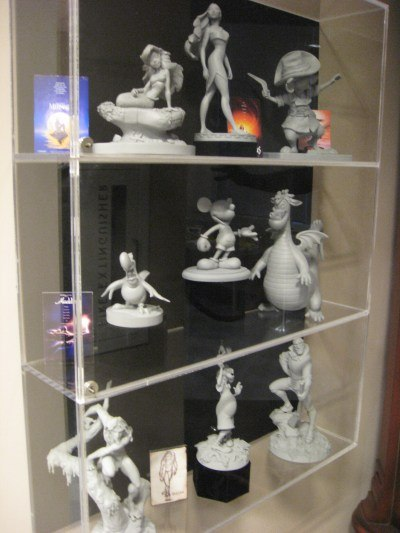 A shelf of macquettes from various Disney feature films.