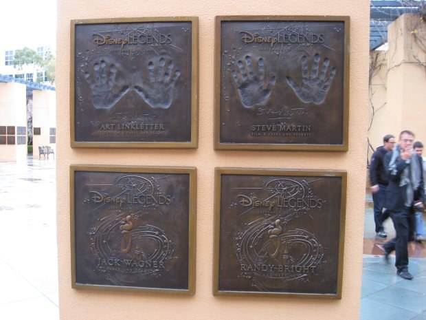Pillars surrounding the Disney Legends Plaza are adorned with handprints from the famed inductees.