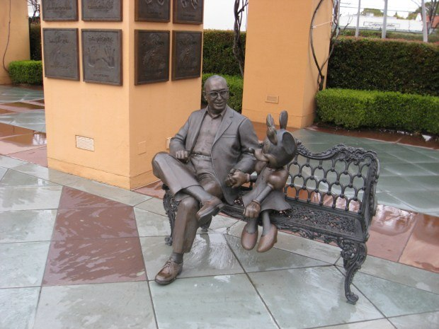 A statue of Roy Disney and Minnie looks over the Legends Plaza. This is an exact replica of the original at Disney Paris.