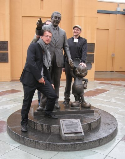 Bastien, Max and a mostly hidden Jakob join Walt and Mickey, standing front and center at one end of the Legends Plaza, overlooking the Eisner building and the 7 Dwarfs Disney made famous.