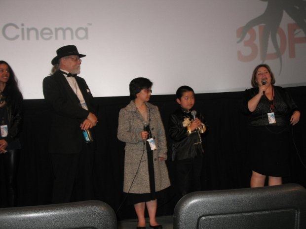 Guard Dog jammers Alta Berri, Larry Loc, Linda Lee watch moderator Jeanette DePatie intro Perry Chen at NMFF premiere.