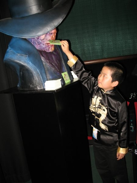 Perry Chen feeding cards to monster at NMFF premiere. (photo by Zhu Shen)
