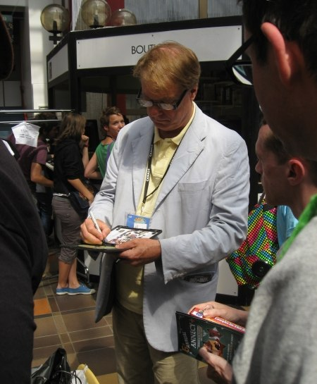 "Bill signing his new book, ""Independently Animated: Bill Plympton!"""