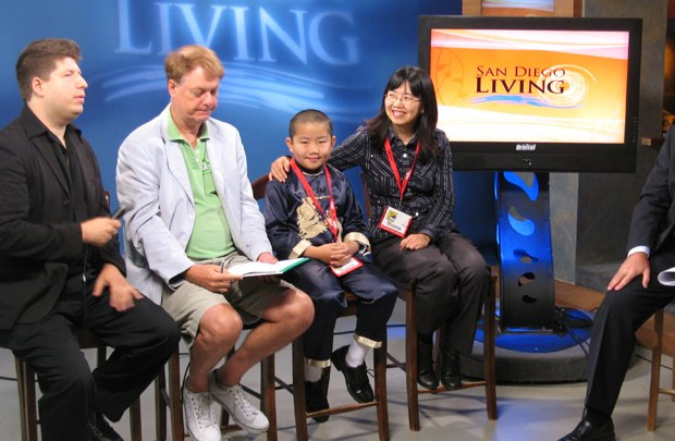 Kevin Sean Michaels (l to r), Bill Plympton, Perry Chen and Zhu Shen talk about their project on a San Diego morning show.