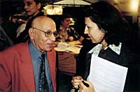 Jean-Luc Xiberras catches up with Annick Teninge, who was assistant director of the Annecy festival before joining AWN as general manager in 1996. Photo by Ron Diamond. © AWN.