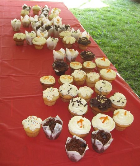 The cultural diversity of the assembled crowd was mirrored in the selection of cupcakes.