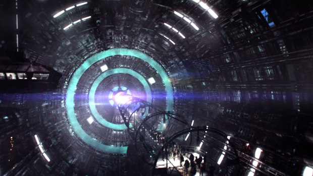 The time travelers enter a huge centrifuge to travel to Terra Nova.
