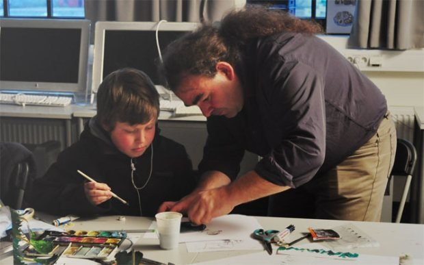 Eric Vanz de Godoy works with an Ani-Camp student.