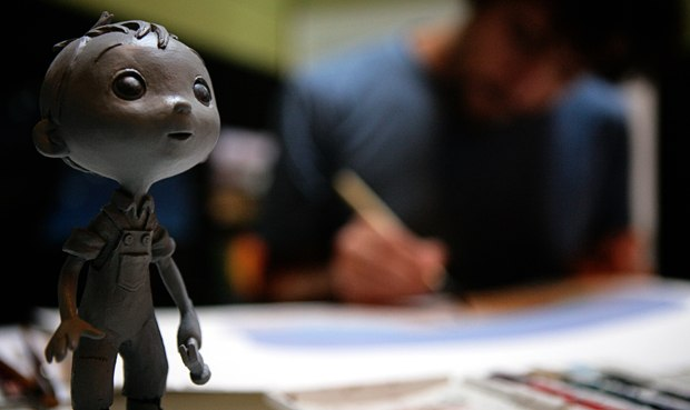 The director at work with his alter ego beside him.