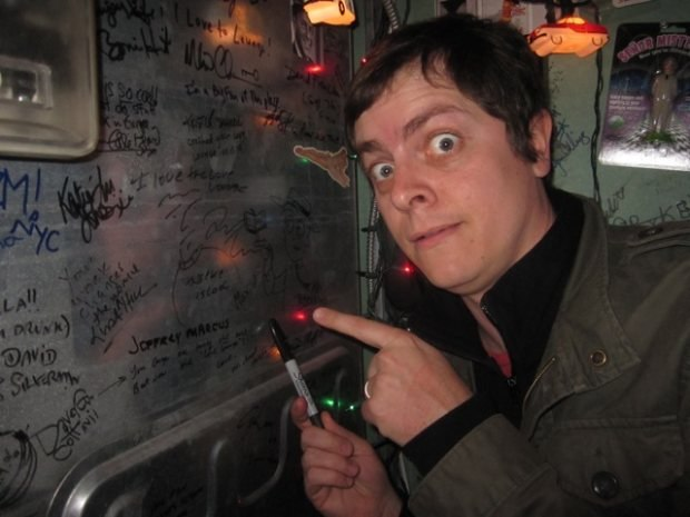 Brandon signs his name in the Love Lounge.