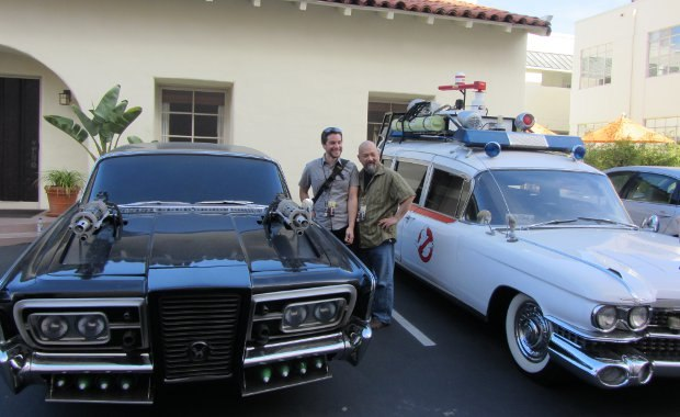 Patrick and Michael beside two very famous movie rides. The Ghostbusters Ectomobile is a working model, while the Green Hornet's Black Beauty has no engine.