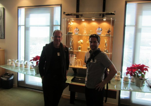 Marc Bertrand (left) and Patrick Doyon (right) in front of display case filled with SPA/SPI awards.