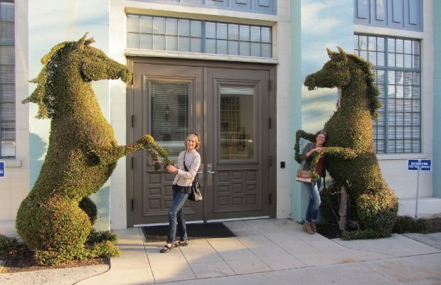 Wendy Tilby (left) and Amanda Forbis (right) horse around with some of the beautifully sculpted hedges that adorn the Fox backlot.