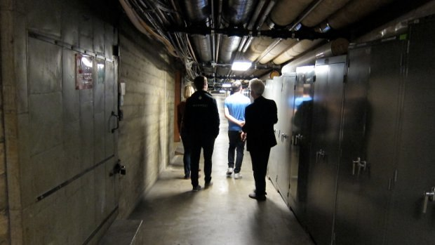 "Traversing the narrow basement hallways on our way to visit the old ""Morgue,"" the old home of the Disney archives."