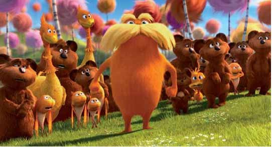 The Lorax stands with the Bar-ba-loots, Swomee-Swans and Humming-Fish.