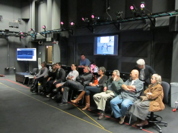 The group watches a demonstration in the expansive motion capture studio.