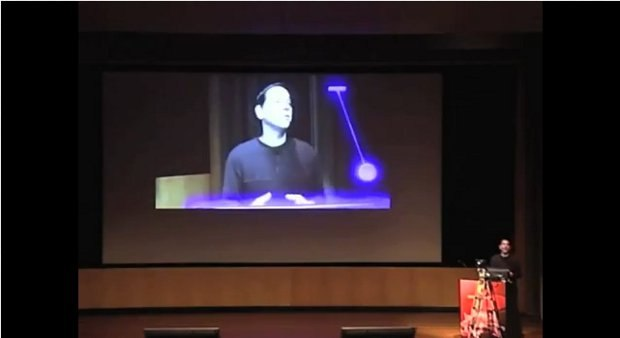 Ken sets the pendulum into motion. It swings back and forth for the audience within his virtual space window. Click here to watch the entire presentation.