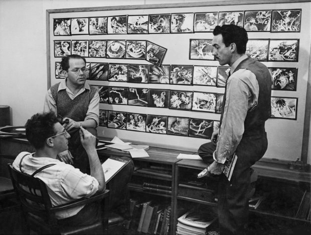 UPA's founders, Zachary Schwartz, David Hilberman, and Stephen Bosustow (left to right), discuss the storyboard for Sparks and Chips Get the Blitz (1943). Image courtesy of Adam Abraham.