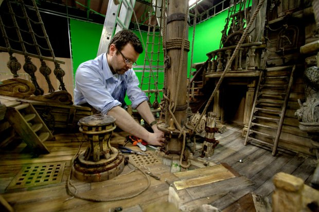 Richard Edmunds, Assistant Art Director, set dresses the Pirate Ship.
