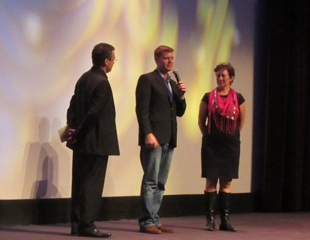 Serge Bromberg, onstage with director John Kahrs and producer Kristina Reed at the opening ceremonies, introducing the world premier screening of Disney's new short, Paperman.