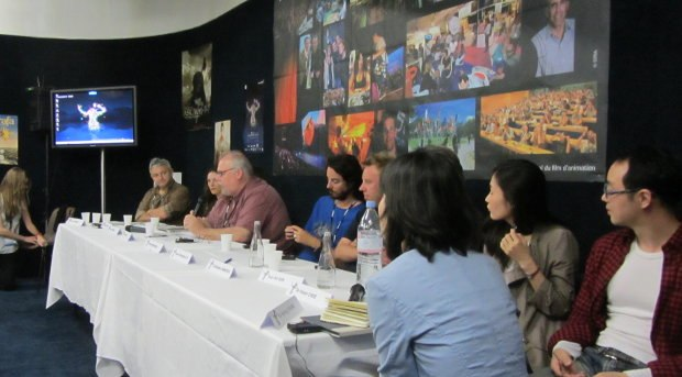 I moderated a press conference Wednesday, presenting three feature film production teams - Zarafa, Crulic: The Path to Beyond and The Dearest. We had to translate questions back and forth in three languages - English, French and Korean. 90 minutes of fun was had by all.