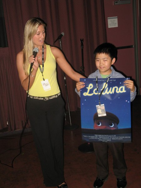 Perry Chen holding La Luna poster at LA Shorts Fest screening, July 2011 (photo by Zhu Shen)