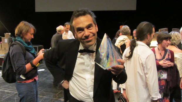 Serge holding up an Annecy Crystal award, closing ceremonies, 2012.