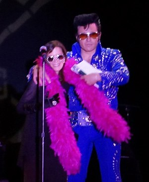 Cathy Guisewite of Cathy with Elvis presenting an award
