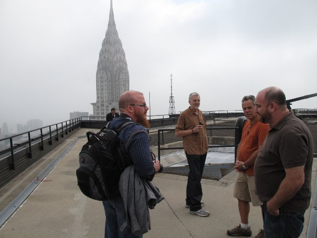 VFX Supervisor Jay Redd (left) along with Ken (middle), location manager Robert Striem (middle right) and key grip Mitchell Andrew Lillian (far right) on a New York City building rooftop during the making of Men in Black 3. Image courtesy of SPI.