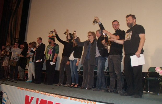 Members of the jury and prizes winners ringing the bell to signify the closing of the 2012 festival.
