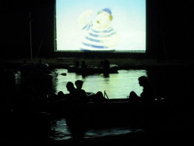 Watching three nighttime screening in the boats