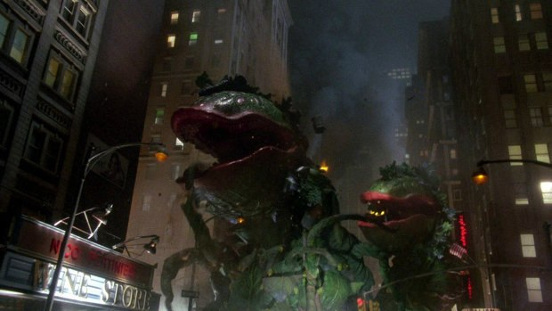 Various Audrey II plants create chaos in the streets.