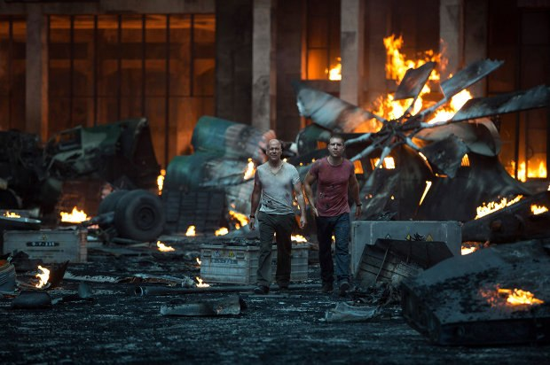 John McClane (Bruce Willis) and son Jack (Jai Courtney) survey the wreckage left after their encounter with a band of assassins in A Good Day to Die Hard. Image TM and © 2013 Twentieth Century Fox Film Corporation. All rights reserved.